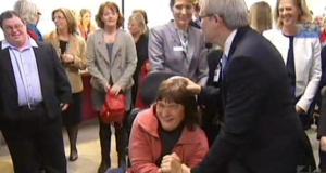 Prime M inisre Kevin Rudd patting a woamn who is using a wheelchair on the head 9.36.38 AM