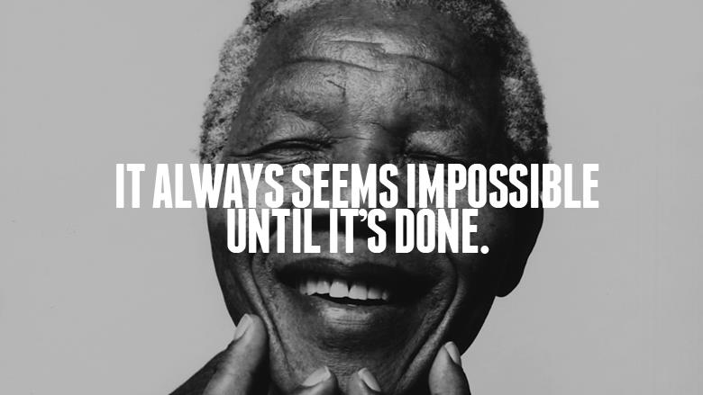 An image of Nelson Mandela, former South African President and African National Congress leader.  He is smiling broadly and holding his chin. Across his face is printed the words 'It always seems impossible until it is done.""